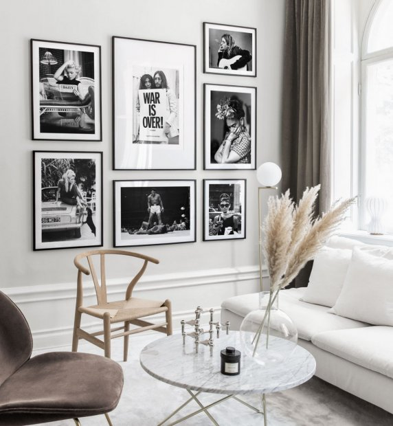Stylish gallery wall in black and white with iconic photo art and black frames