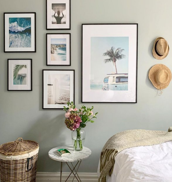 Gallery wall with beach prints in walnut frames