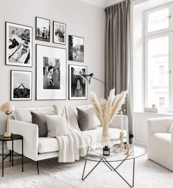 Black and white gallery wall with iconic posters in black metal frames