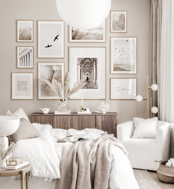 Elegant art gallery wall beige bedroom nature posters oak frames